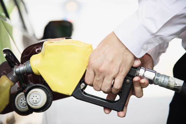 man-putting-gasoline-fuel-into-his-car-pump-gas-station_1150-14574
